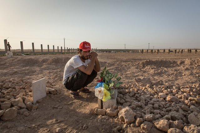 Tal Abyad. Ismael bitterly gathered at the grave of Hout, his friend and cousin, who died in combat less than 48 hours before.